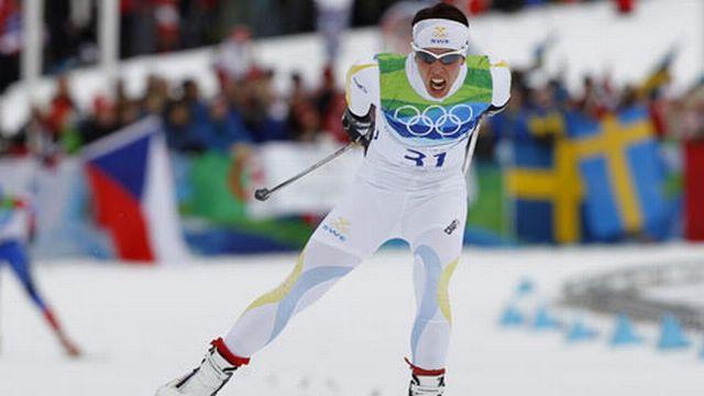 Charlotte Kalla a offert une 1ère médaille d'or à la Suède. [Keystone]