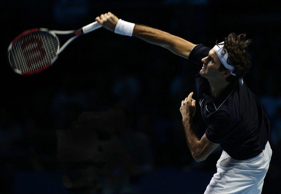 Roger Federer au service [JONATHAN BRADY - Keystone]