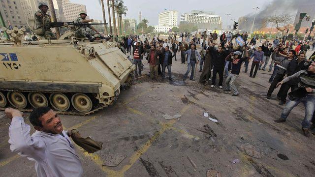 Les manifestations ont parfois tourné à l'émeute en Egypte. [Ben Curtis - Keystone]