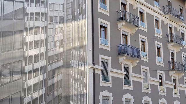 Un trompe l'oeil en ville de Genève en pleine crise de logements. [Martial Trezzini - Keystone]