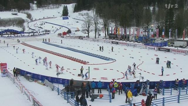 Ski de Fond / Tour de ski:on passe du style classique au style libre, en changeant de ski. Cologna est en tête
