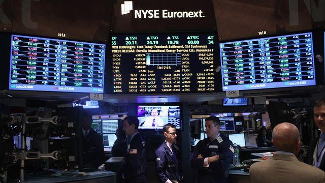 Des traders à la bourse de New-York. [Spencer Platt - Getty Images/AFP ]