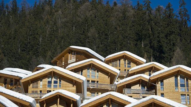 Faut-il limiter la construction de résidences secondaires? Le peuple se prononcera le 11 mars prochain. [Jean-Christophe Bott - Keystone]