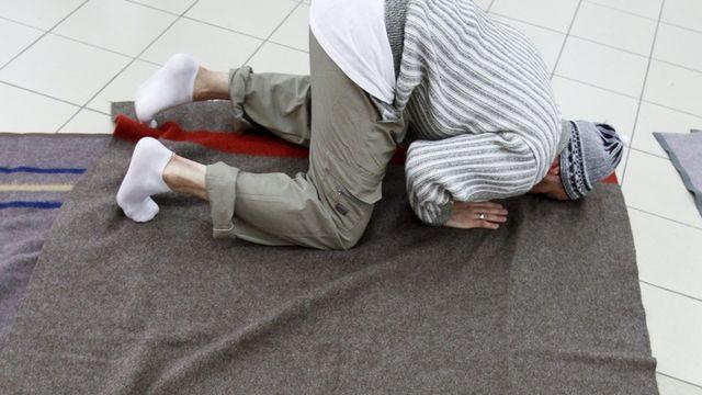 Se convertir à l'islam relève avant tout d'une dimension individuelle. [Arno Balzarini - Keystone]