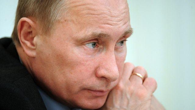 Selon Vladimir Poutine, les leaders de l'opposition sont prêts à toutes les dérives pour lui barrer la route. [Alexei Druzhinin - Keystone]