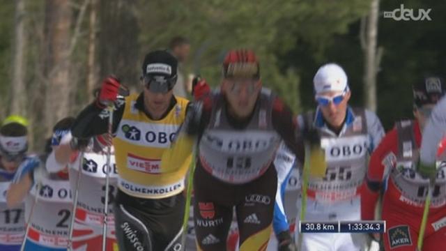 50 km: passage au 30,8 km. Cologna 5e, en bonne position dans le peloton des favoris. Eliassen (NOR) en tête devant Filbrich (ALL)