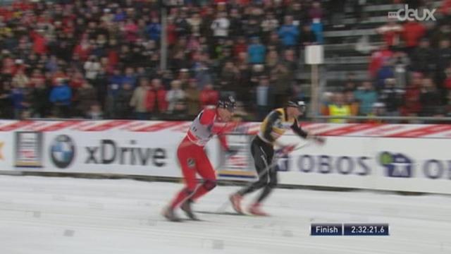 50 km: le dernier kilomètre. Dario Cologna finalement est battu sur le fil par le Norvégien Roenning