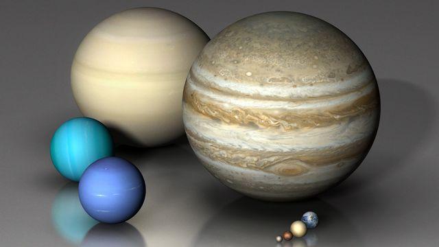 Les huit planètes du système solaire et la planète naine Pluton. [Mark Garlick / MGA / Science Photo Library - AFP]