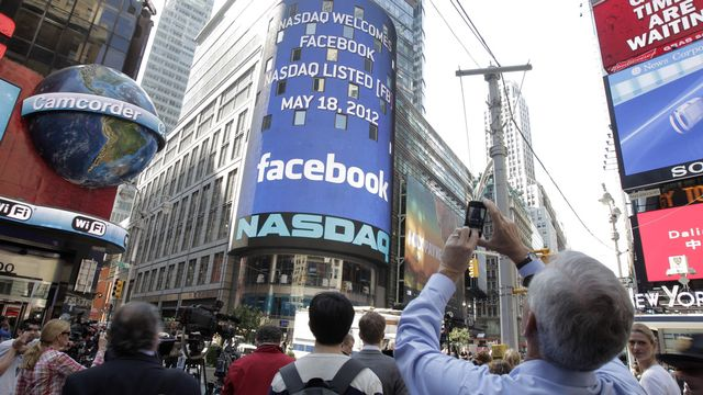 Facebook fait son entrée en bourse [Richard Drew - Keystone]