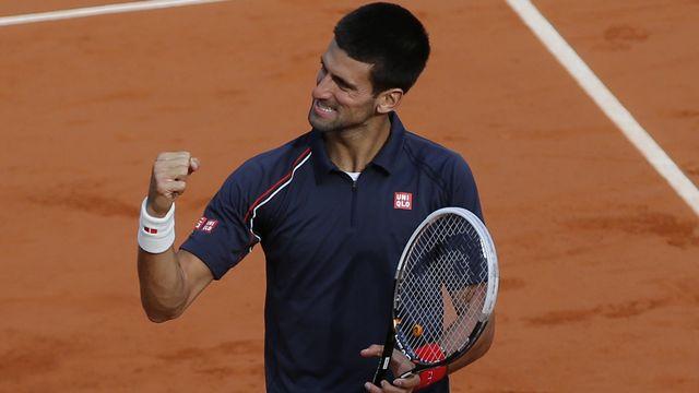 """Djokovic retrouvera Nadal en finale d'un """"Majeur"""" pour la 4e fois. [Christophe Ena - Keystone]"""
