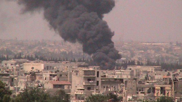 Scène de bombardement d'un quartier de Homs. [Shaam - Reuters]