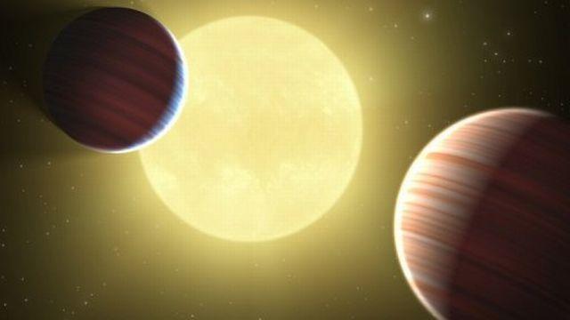 Dessin de deux planètes de la taille de saturne en orbite autour d'une étoile [AFP]