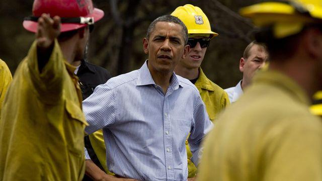 Le président sortant des Etats-Unis, Barack Obama s'est rendu sur le front des incendies dans le Colorado, vendredi 29 juin. [Carolyn Kaster - Keystone]