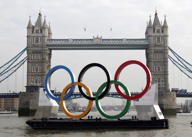 Les téléspectateurs américians doivent le plus souvent se contenter de suivre les JO de Londres en différé... [Alastair Grant - Keystone]