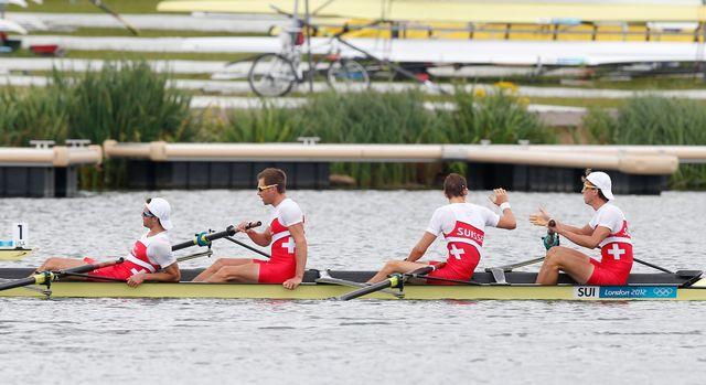 Les Suisses se congratulent. Ils se sont offert une place dans la finale A, donc une place dans le top-6 olympique. [Jim Young - Reuters]
