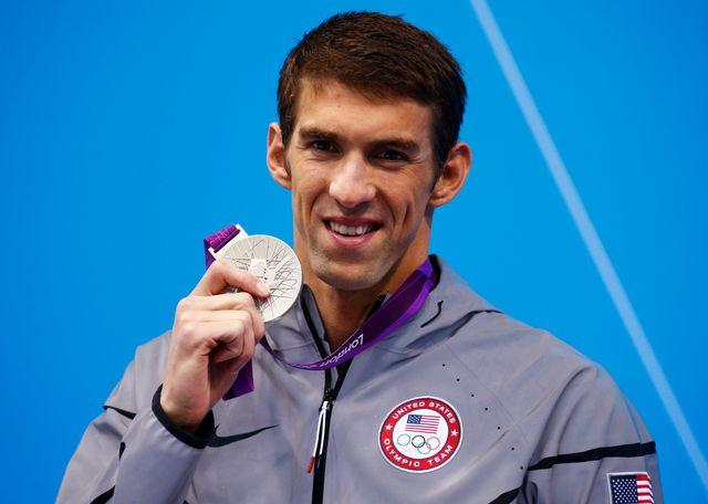 Michael Phelps peut sourire. Il est désormais l'athlète le plus médaillé de l'histoire olympique. [David Gray - Reuters]