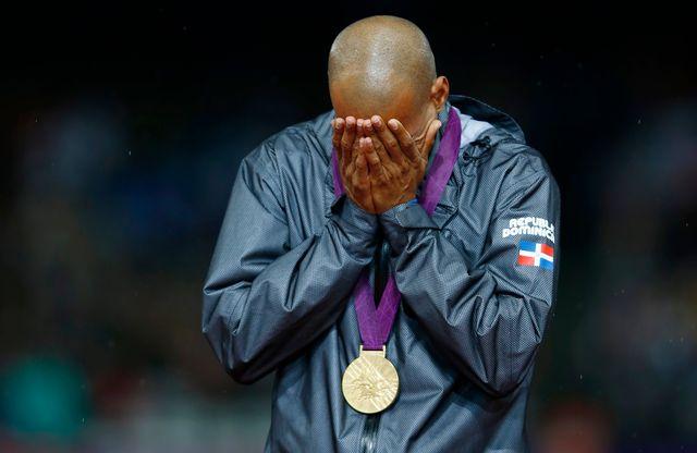 Emu aux larmes, Félix Sanchez s'est offert un superbe titre olympique au crépuscule de sa carrière. [Eddie Keogh - Reuters]