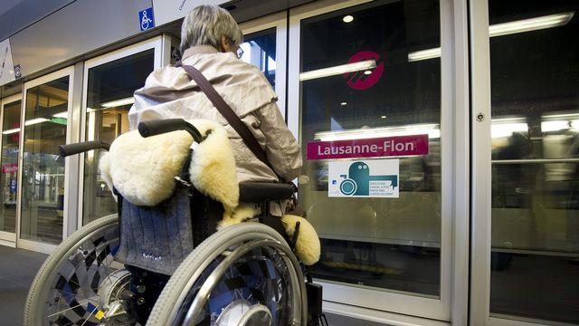 Une contribution pour rendre les invalides plus autonomes. [Jean-Christophe Bott - KEYSTONE]