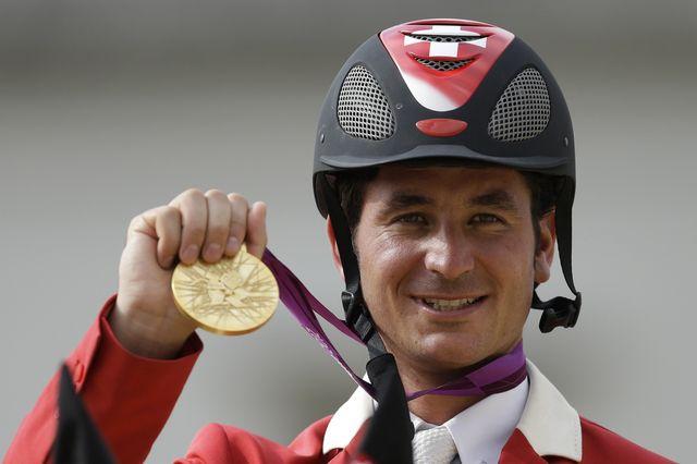 Guerdat obtient sa deuxième médaille olympique après Pékin (bronze par équipes). [AP   - Keystone]