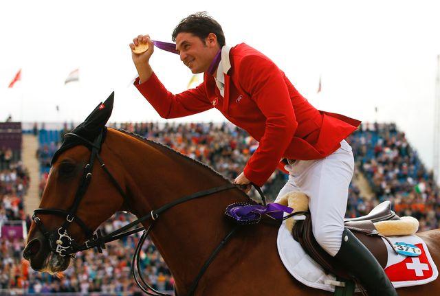 Le duo gagnant de la journée pour la Suisse s'est offert un magnifique tour de piste.  [Brian Snyder - Reuters]