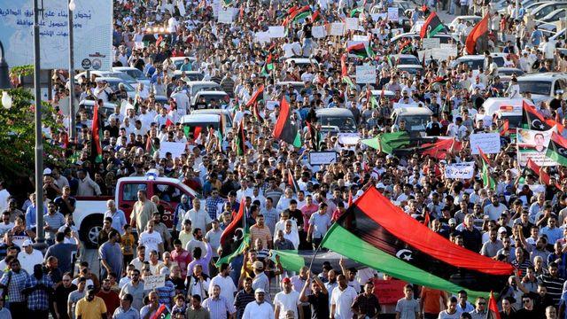Des milliers d'habitants de Benghazi en Libye ont chassé de leur ville la milice islamiste Ansar al-Charia. [Mohammed Elryani - Keystone]