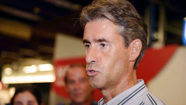 Christian Varone, le 1er août 2012, lors de son arrivée à l'aéroport de Kloten.  [Walter Bieri]