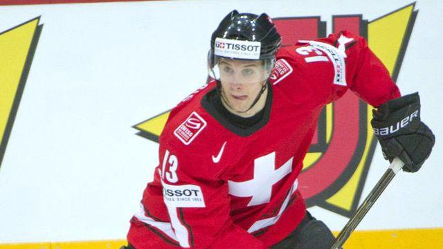 Le joueur de Kloten Félicien Du Bois. Ici avec les couleurs de l'équipe suisse de hockey. [Markku Ojala - EPA/Keystone]
