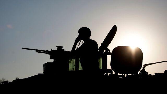 L'opération militaire israélienne contre les groupes armés du territoire palestinien est largement relayée sur les réseaux sociaux, par l'armée israélienne et par le Hamas. [Ariel Schalit - Keystone]