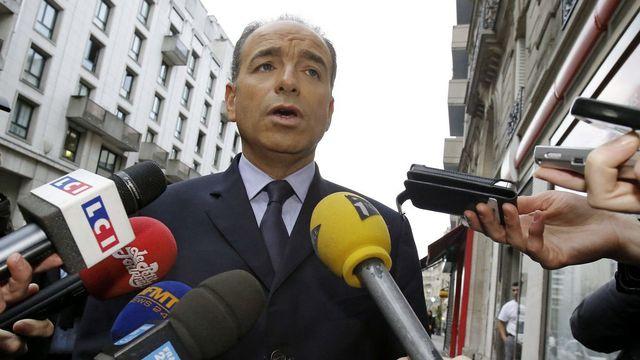 Jean-François Copé assailli par les médias ce lundi 26.11.2012 à Paris. [Michel Euler - Keystone]