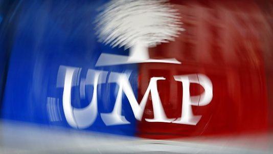 En France, l'UMP, criblée de dettes, devra réduire la voilure pour tenir jusqu'en 2017. [Kenzo Tribouillard - AFP]