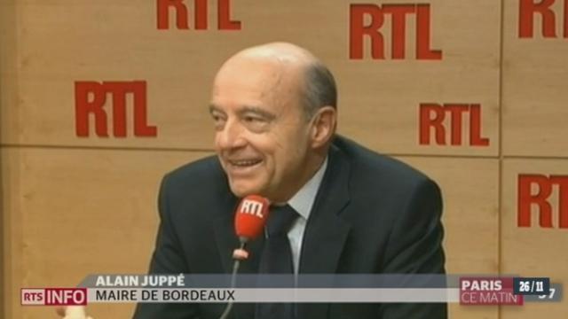 En France, plus d'une semaine après une élection interne controversée, l'UMP est en voie de scission