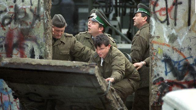 Le 9 novembre 1989, le mur tombe sous la pression populaire, après 28 ans de scission des deux Etats. [DPA/AFP - AFP]