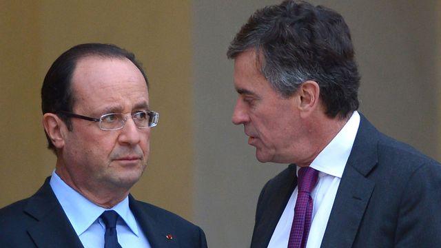 Le président français François Hollande et son ex-ministre des Finances Jérôme Cahuzac. [Miguel Medina - AFP]