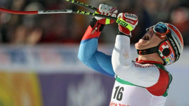 La consécration en 2009 aux championnats du monde de Val d'Isère: l'enfant des Bugnenets remporte le Super-G, son seul titre mondial. Il a aussi enlevé l'argent en descente à Val d'Isère la même année, l'argent en descente à Garmisch en 2011 et le bronze en géant à Are en 2007. [Ian Langsdon - Keystone]