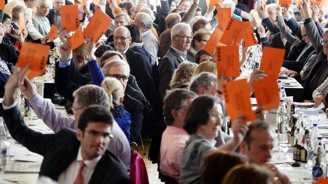 """Le PDC a dit un """"oui"""" net au durcissement de l'asile lors de son assemblée de Heiden, ce samedi 20 avril. [Walter Bieri - Keystone]"""