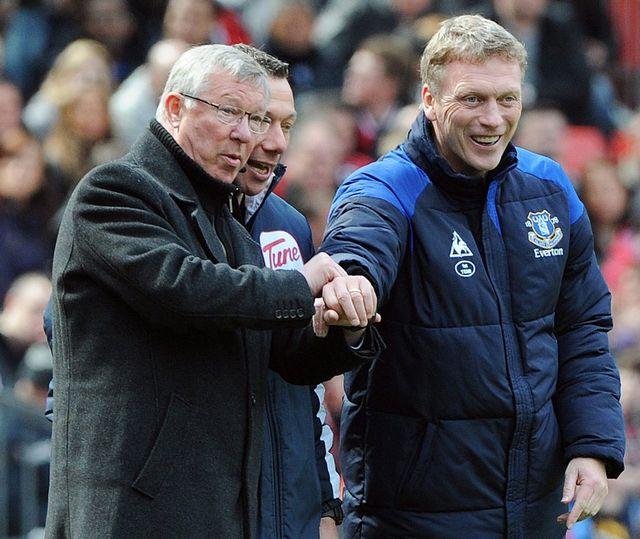 Moyes, tout à droite, remplace son compatriote à la tête de United. [Peter Powell - Keystone]