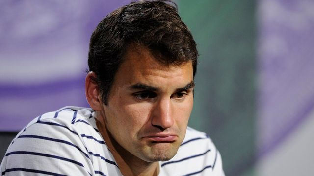 Roger Federer n'a pas caché sa déception après son élimination à Wimbledon. [AP Photo/AELTC, Thomas Lovelock - Keystone]