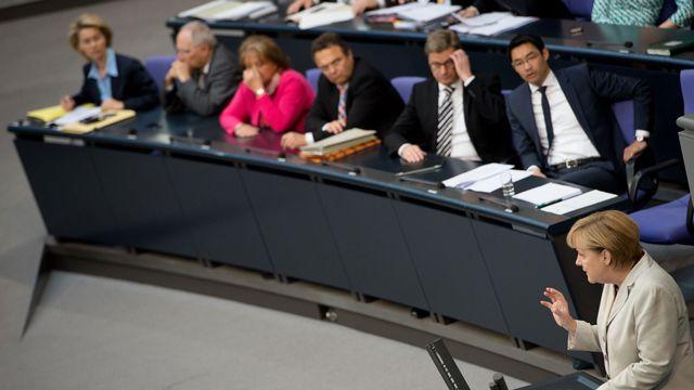 La chancelière allemande Angela Merkel devant le sommet européen ce jeudi 27.06.2013. [Hohannes Eisele - AFP]