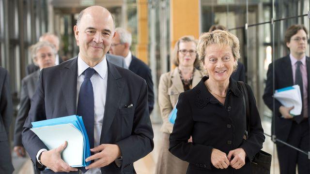 La convention signée par P. Moscovici et E. Widmer-Schlumpf va beaucoup plus loin que celles existant avec d'autres Etats. [Lionel Bonaventure - AFP]