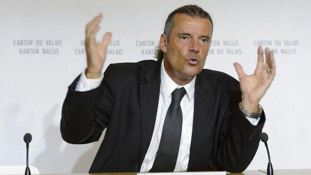 Le conseiller d'Etat valaisan Oskar Freysinger en conférence de presse à l'occasion de ses cent jours au gouvernement valaisan le 8 août 2013 a Sion. [Laurent Gilliéron - Keystone]