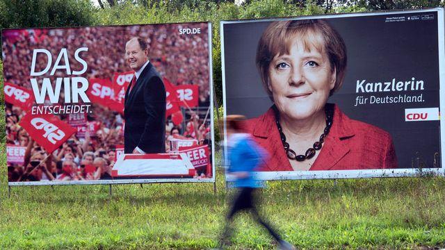 Angela Merkel est donnée favorite face à Peer Steinbrück. [Federico Gambarini - EPA/Keystone]