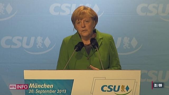Elections législatives allemandes: Angela Merkel bénéficierait d'une courte avance [RTS]