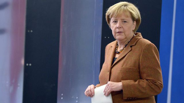 Angela Merkel devrait l'emporter, mais dans quel contexte? [Federico Gambarini - EPA/Keystone]
