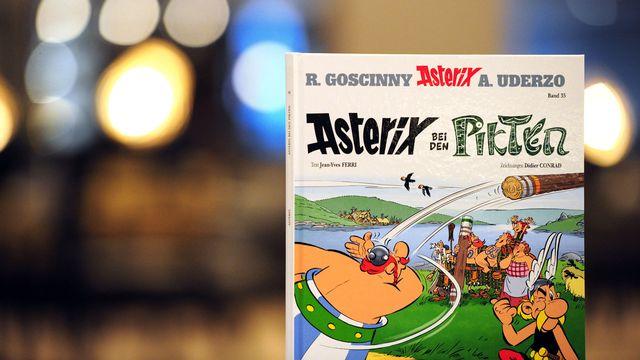 """L'album """"Asterix chez les Pictes"""" est traduit en 24 langues. Ici la version allemande. [Daniel Reinhardt - dpa Picture-Alliance/AFP]"""