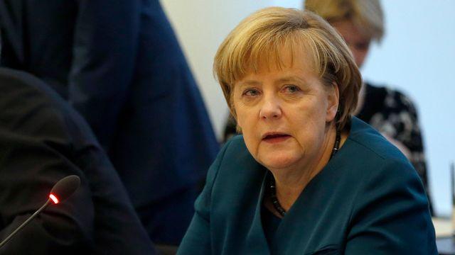 Angela Merkel doit faire des concessions pour trouver un accord de gouvernement avec le SPD. [AP Photo/Michael Sohn - Keystone]