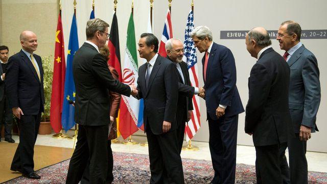 L'accord trouvé dimanche à l'aube à Genève permet une levée des sanctions contre une réduction de l'uranium iranien. [Martial Trezzini - Keystone]