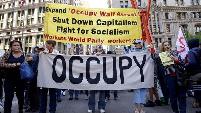 """Le mouvement """"Occupy Wall Street"""" révèlent les dessous des rachats de dettes aux USA. [Justin Lane - EPA/Keystone]"""