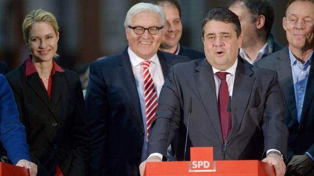 Le SPD a accepté l'alliance avec les conservateurs de la CDU. [Rainer Jensen - AP/Keystone]