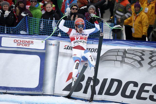 Patrick Küng devient le 10e Suisse à s'imposer sur la mythique piste du Lauberhorn. [Peter Klaunzer - Keystone]