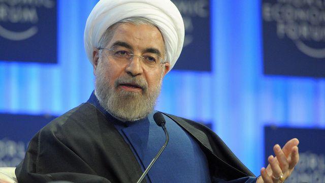 """""""Nous sommes tous dans le même bateau"""", a lancé le président iranien à Davos. [Eric Piermont - AFP]"""